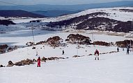skiing falls creek over the mountain, close to the lake